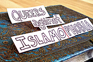 The words Queers against Islamophobia (written on paper, by hand), appear on the cover of a blue and gold journal.