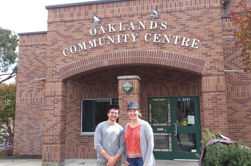 Kingsley Strudwick and Cindy Allen standing in from of Oaklands Community Association, a brick building.