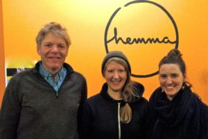 A photo of Michael (founder of hemma, acupuncturist, & yoga teacher), Alison (front deskfront desk staff, yoga teacher, & and homebody coordinator), and Kelly (manager)