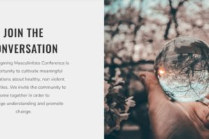Join the conversation. A hand holds a crystal ball, so that an image on a tree in the background is seen upside down in the ball