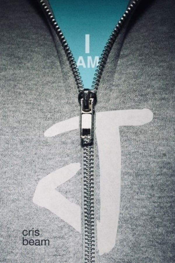 Book cover - a grey zip-up hoodie with a blue shirt underneath. As the hoodie unzips, it reveals the text 'I am J'