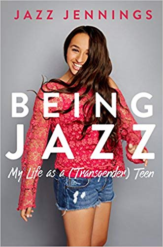 Book Cover - Author with long brown hair, smiling, wearing pink sweater and jean cut-off shorts